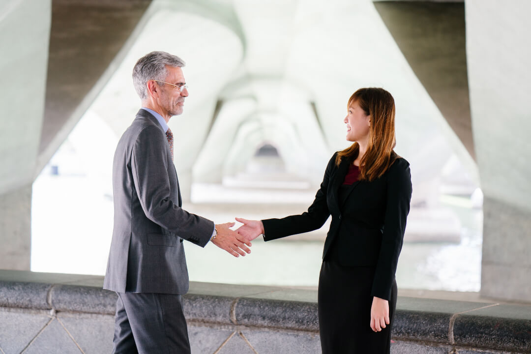 two people shaking hands - Is a Series LLC Right For Your Business?