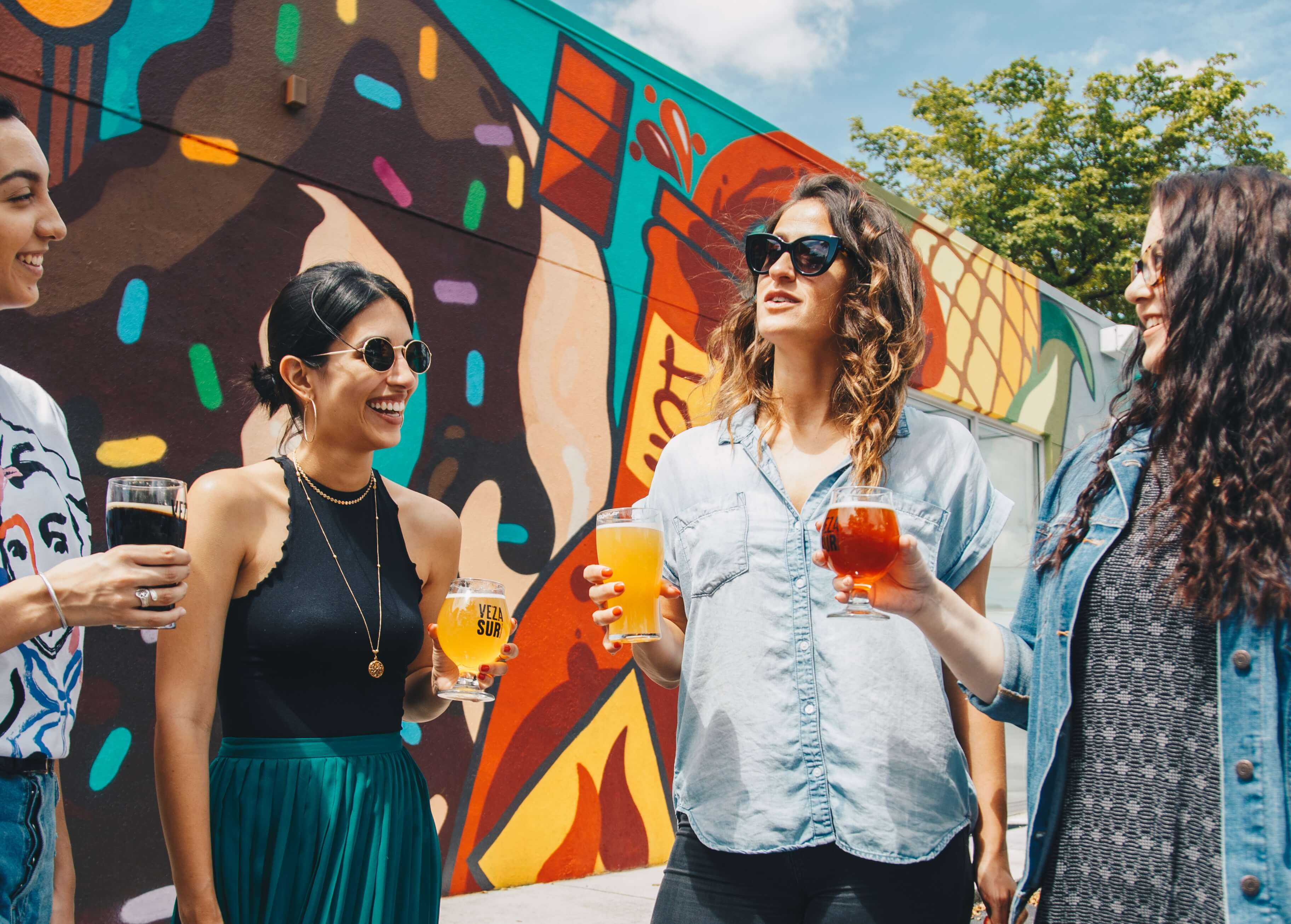 Four women drinking local wares in a Missouri neighborhood