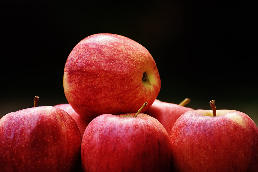 Red apples against a black background